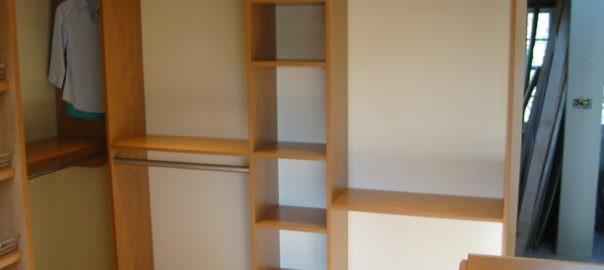 Built-in shelves in master bedroom closet