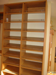 Shoe rack storage in master bedroom closet